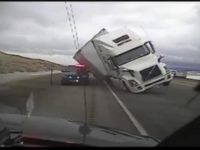 Say What?!: Wind Blows Semi Truck onto Unoccupied Police Car in Wyoming