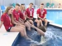 Say What?!: BBC Reporter Interviewing Swimmers Falls into Pool