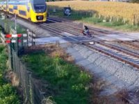 Say What?!: Cyclist's Near Miss with Oncoming Train Caught on Video