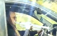 Say What?!: Man Plays Trumpet While Driving on Busy Highway