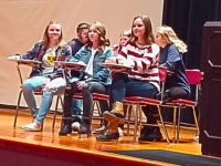 Jenna Ceriani (right) participates in an INAM skit to help seventh graders learn about bullying.