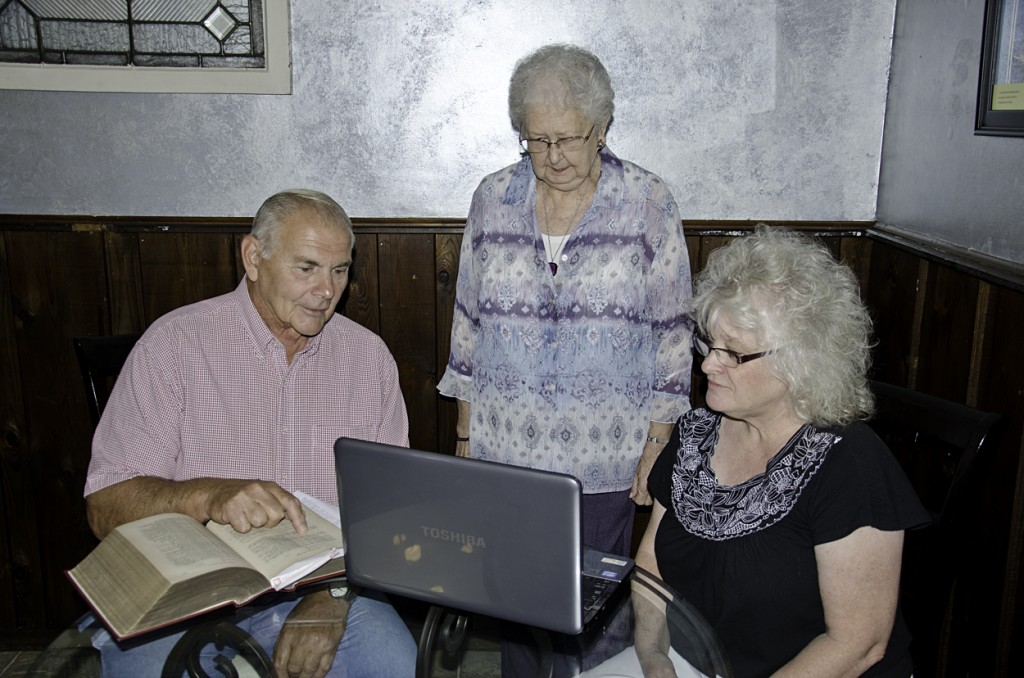 MRS. NORMA TROUP (center), a South Bethlehem resident whose great-grandfather served in the Civil War, receives guidance from Cindy Morgan, president of the Redbank Valley Historical Society, and Don Shilling, another society member.