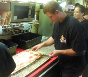Devin Mesoraco helps make a pizza during the 13th Annual Pizza & Prevention event.