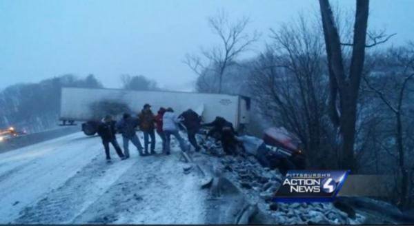 Bystanders-form-a-human-chain-to-rescue-man-from-teetering-truck