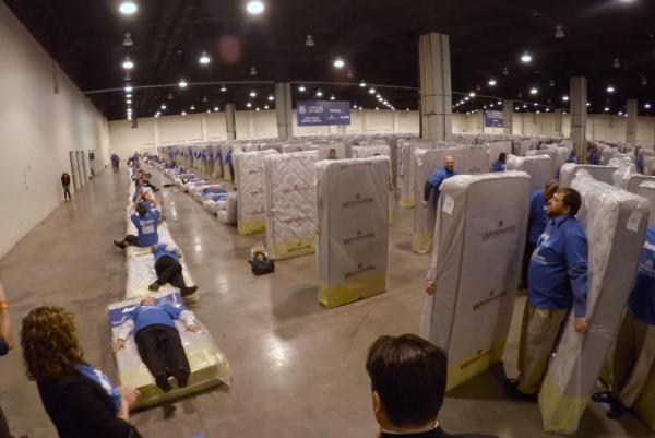 Guinness-record-for-human-mattress-dominoes-broken-with-1200-participants