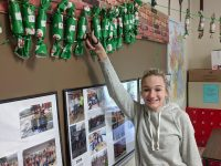 9th Grader Kaitlyn Puhala shows off her class's Christmas chain.