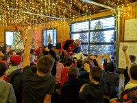 Mr. Kazam does magic for children at the Brockway Community Christmas Party.
