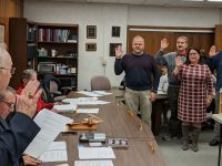 Solicitor Ed Ferraro (left) administers the oath of office to Ed Yahner, James Brown, Katie Bish, Robert Grecco, and Jacqueline Manno.